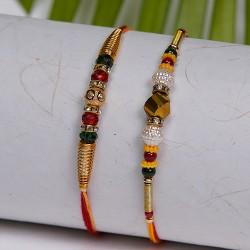 Set of 2 Golden Beads with Crystal Rakhis