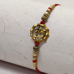 Metallic  OM Motif Rakhi with Pearls, Beads and AD