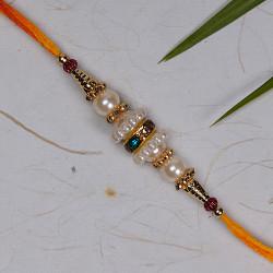 Pearls Rakhi with Golden Beads