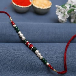Fabulous Green and Maroon Beads Bracelet Style Rakhi with Pearl and AD