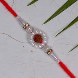 Pearls and Rudraksh Rakhi with American Diamonds