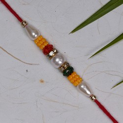 Fancy Pearls Crystals Beads and AD Studded Rakhi