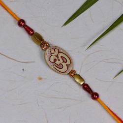 Auspicious OM Motif with Colored Beads Rakhi