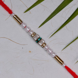 White Pearls Rakhi with AD and Beads